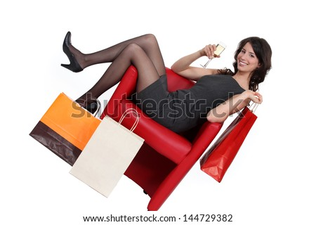 Woman celebrating her shopping - stock photo