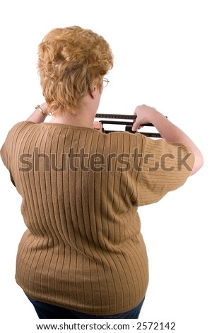 woman checking her weight on scale isolated on white