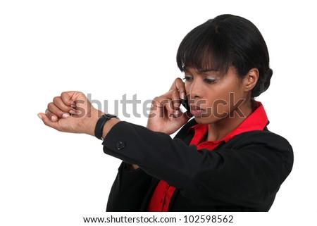 Woman checking watch - stock photo