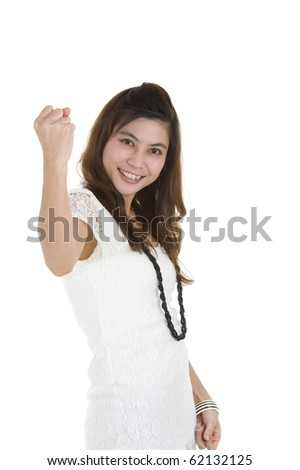 woman cheering with her fist in the air, isolated on white background - stock photo