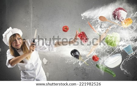 Woman chef has problems in the kitchen - stock photo