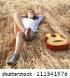 Woman chilling in wheat field - stock photo