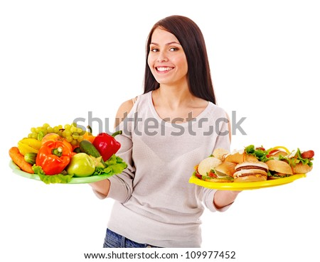Woman choosing between healthy and unhealthy eating. - stock photo