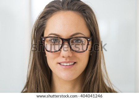 Woman choosing her new glasses