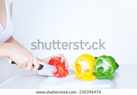 Woman chopping bell peppers - stock photo