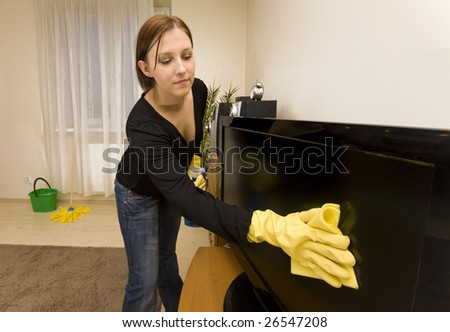 Woman cleaning house in gloves - stock photo