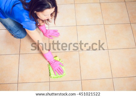 Woman cleaning kitchen. Portrait Of Young Woman Mopping Floor At Home - stock photo