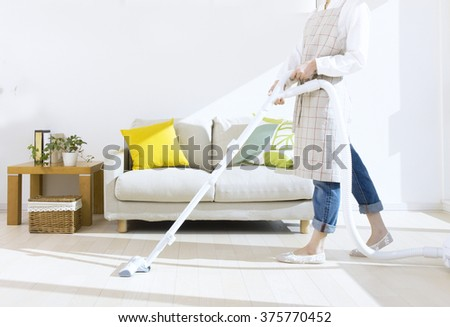 woman cleaning the room - stock photo