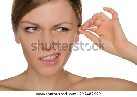woman cleans ears with cotton sticks isolated on white