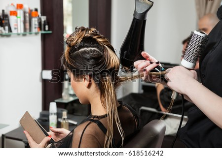 Woman client getting a hairstyle in salon. Professional service. Beauty and treatment