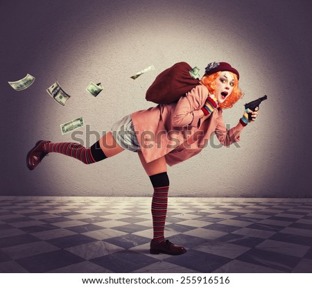 Woman clown thief escapes with the loot - stock photo