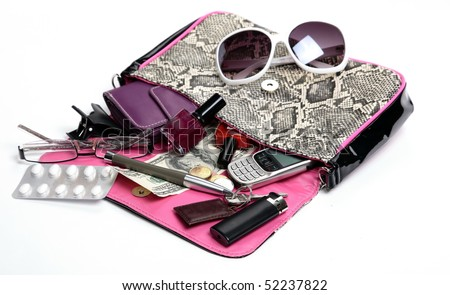 Woman Clutch Bag with some of its Contents. - stock photo