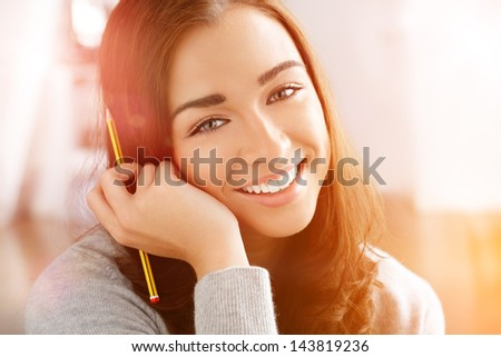 Woman college student studying at home portrait smiling - stock photo