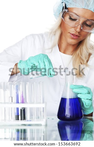 Woman  conducting a chemical experiment - stock photo