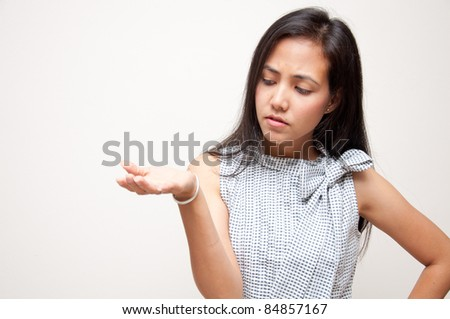 woman confuse something on hand