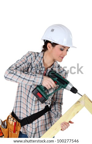 Woman constructing wooden frame - stock photo
