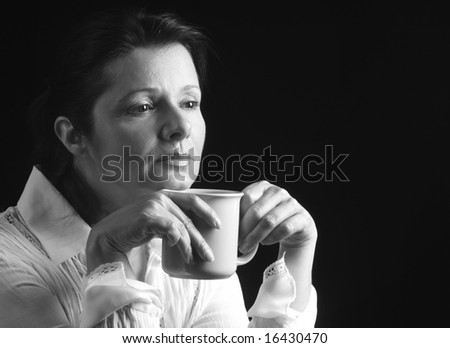 Woman contemplating questions of life over a cup of coffee - stock photo