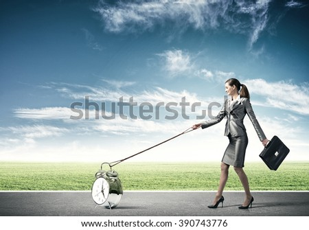 Woman controlling time - stock photo
