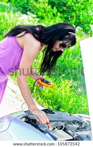 Woman controls lead - stock photo