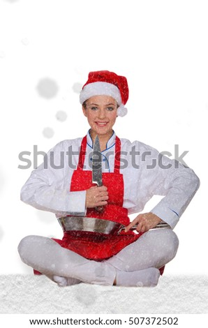 Woman cook in Santa Claus hat, yoga, knife under snow on white background