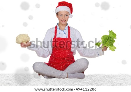 Woman cook in Santa hat, yoga, vegetables under snow on white background