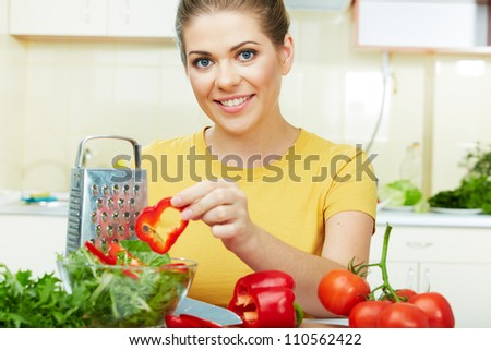 woman cooking in the kitchen healthy vegetarian food