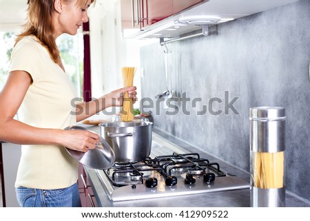 woman cooking pasta in a kitchen