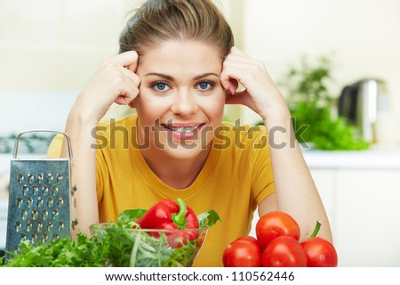 woman cooking vegetables green  salad in the kitchen