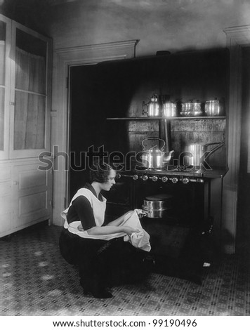 Woman cooking with oven