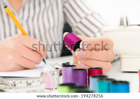 woman counting inventory - stock photo