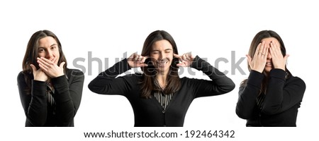 woman covering her eyes, her mouth, and her ears - stock photo