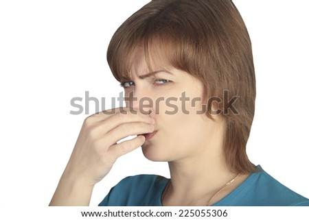woman covering her nose with his hand because of the bad smell