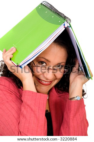 Woman covering herself with a notebook over a white background - stock photo