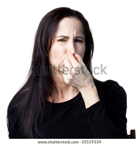 Woman covers her nose, bad smells in the air - stock photo