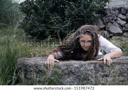 woman creeping out of a hole - stock photo