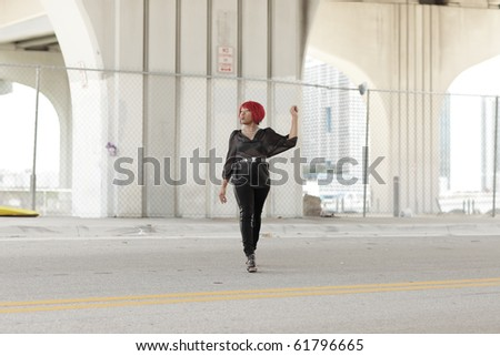 Woman crossing the street - stock photo
