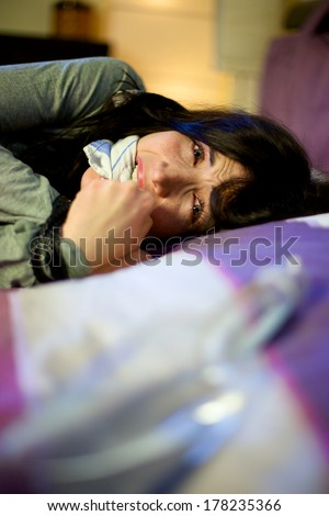 Woman crying desperate kidnapped and abused - stock photo