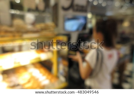 Woman customer buy cake at Bakery cafe shop, blur abstract background concept