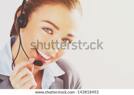 woman customer service agent professional telephone worker - stock photo