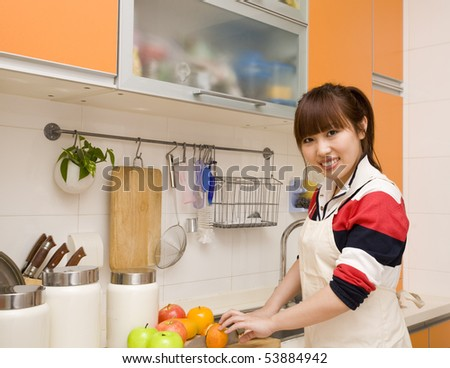 woman cutting fruits - stock photo