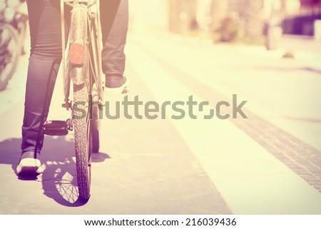 woman cycling at beach  - stock photo