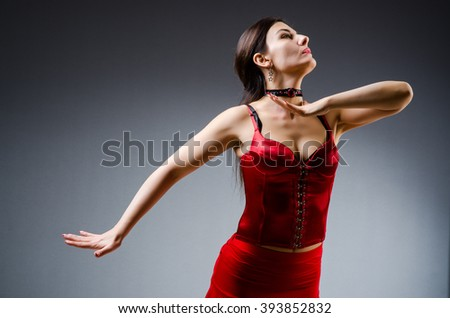 Woman dancing dances in red dress - stock photo