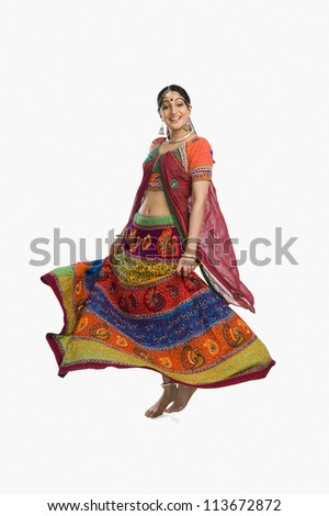 Woman dancing in colorful lehenga choli - stock photo