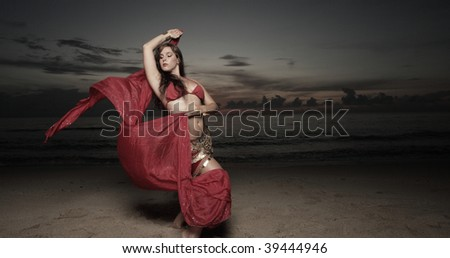 Woman dancing with a red veil - stock photo