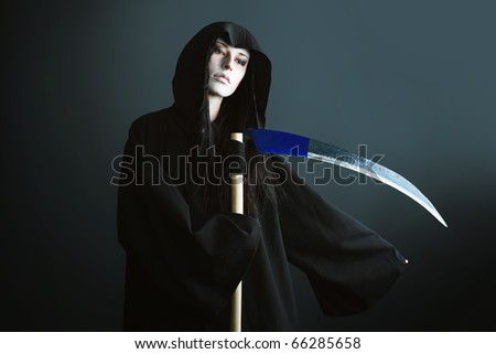 Woman death reaper over black background. Halloween. - stock photo