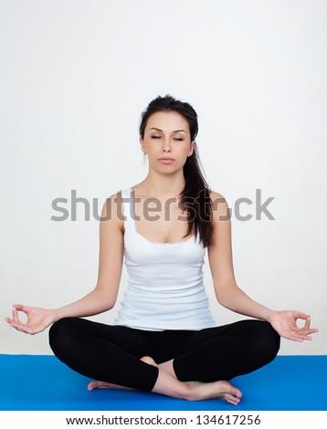 Woman demonstrating Sukhasana or Easy yoga pose - stock photo