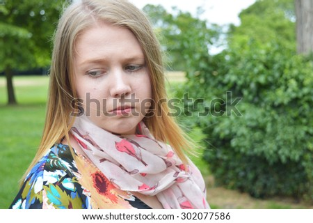 Woman depressed in the park