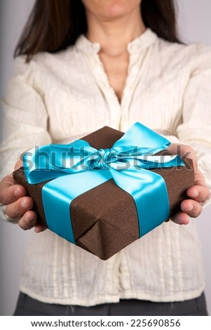 woman detail with a gift box in her hands - stock photo