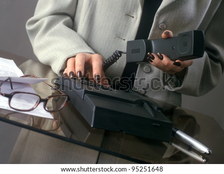 Woman dialing customer - stock photo