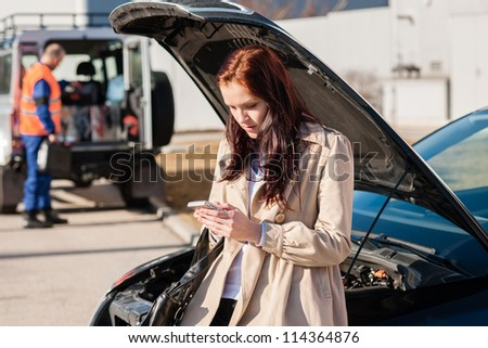 Woman dialing her phone after car breakdown problem mechanic crash - stock photo